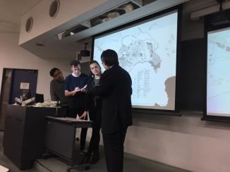 Hayden (writing notes) at presentation at Waseda University with team mates Jack and Natalie and Hijikata Sensei